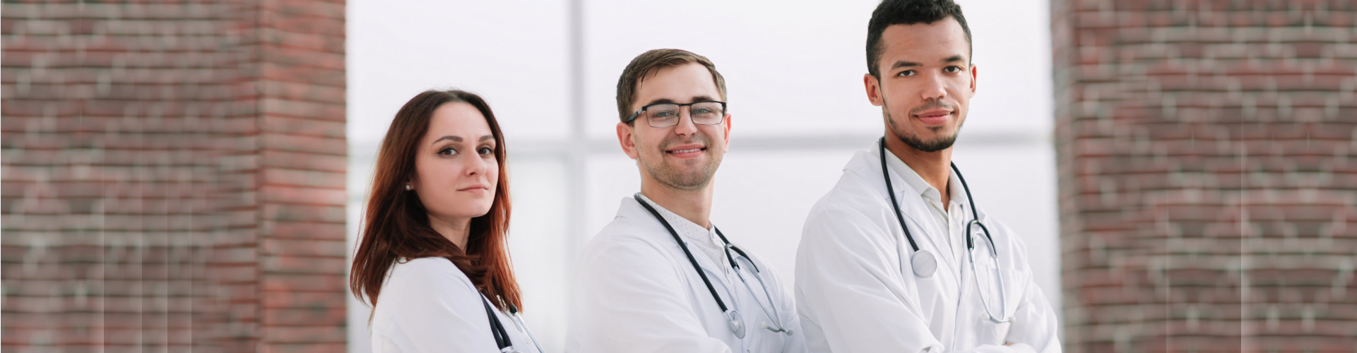 medical staffs standing side by side with arms crossed
