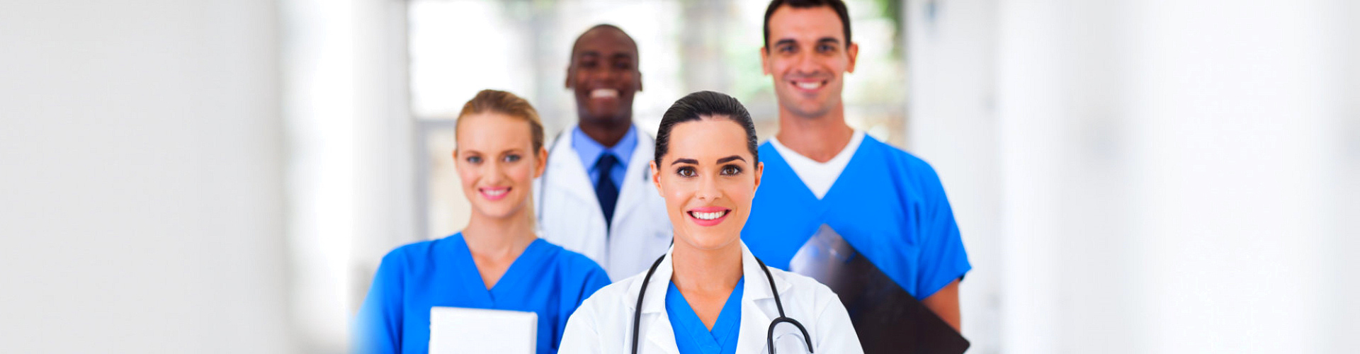 medical staffs smiling while standing on the lobby