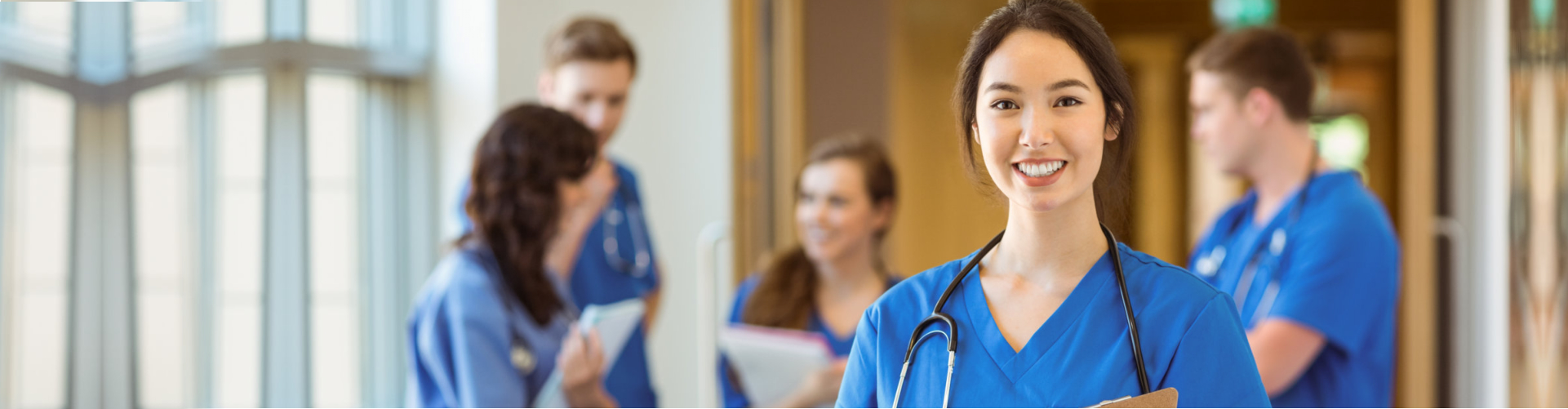 nurse smiling with colleagues at the background