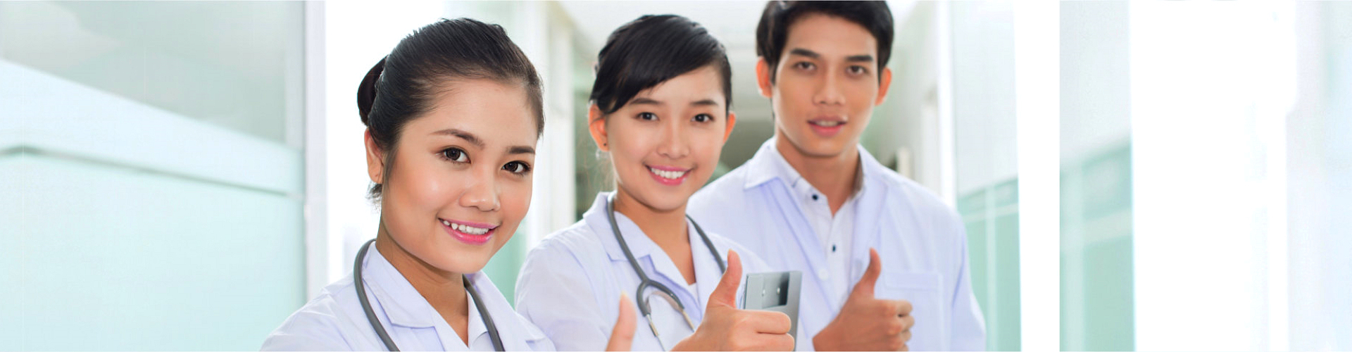 nurses signing thumbs up